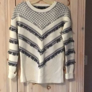 Beautiful cream sweater with black trim